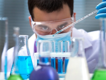 scientist mixing chemicals blog